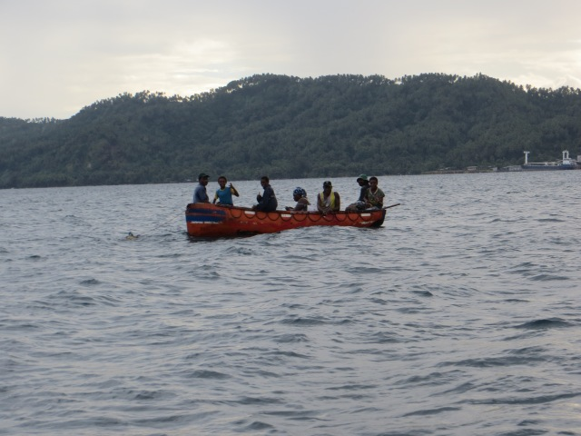 Inhabitants of Rabaul fishing near the shores of Tavurvur
