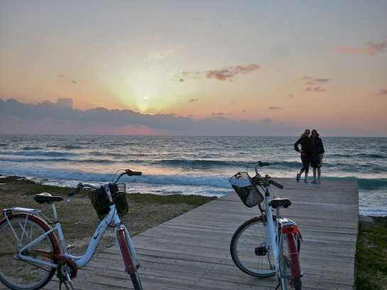 Biking on the promenade at sunset